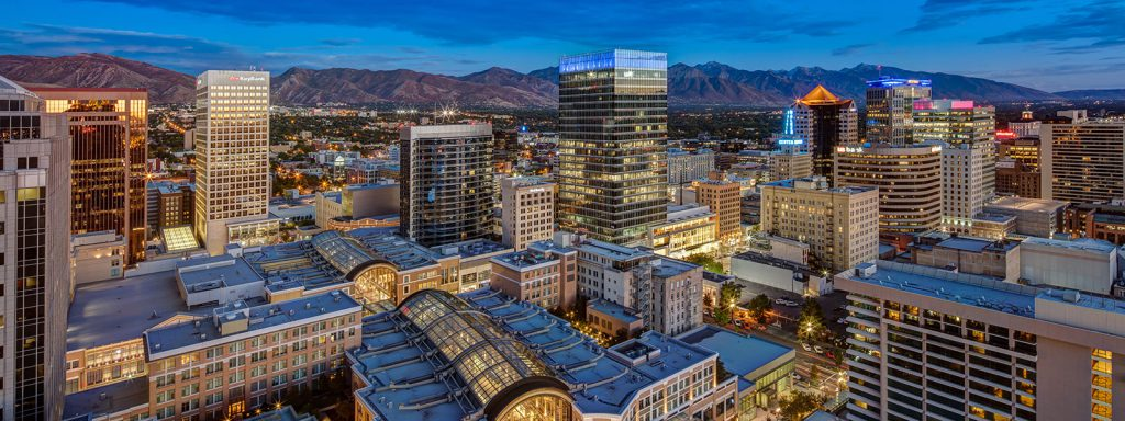 City scape of downtown Salt Lake City at dusk with the City Creek Center in the foreground and 111 Main at the center of the photo